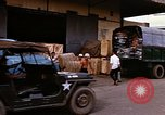 Image of loading cargo onto military trucks Saigon Vietnam, 1966, second 12 stock footage video 65675037338