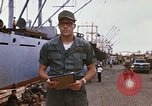 Image of United States army officer Saigon Vietnam, 1966, second 11 stock footage video 65675037339
