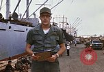 Image of United States army officer Saigon Vietnam, 1966, second 12 stock footage video 65675037339