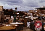 Image of oil barrels Saigon Vietnam, 1966, second 9 stock footage video 65675037340