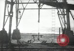 Image of oil derricks Huntington Beach California USA, 1938, second 1 stock footage video 65675037514