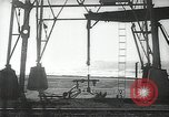 Image of oil derricks Huntington Beach California USA, 1938, second 2 stock footage video 65675037514