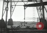 Image of oil derricks Huntington Beach California USA, 1938, second 3 stock footage video 65675037514