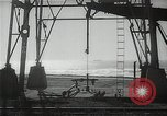 Image of oil derricks Huntington Beach California USA, 1938, second 4 stock footage video 65675037514