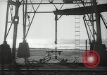 Image of oil derricks Huntington Beach California USA, 1938, second 6 stock footage video 65675037514