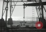 Image of oil derricks Huntington Beach California USA, 1938, second 7 stock footage video 65675037514