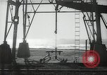 Image of oil derricks Huntington Beach California USA, 1938, second 8 stock footage video 65675037514