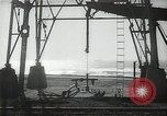 Image of oil derricks Huntington Beach California USA, 1938, second 9 stock footage video 65675037514