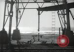 Image of oil derricks Huntington Beach California USA, 1938, second 10 stock footage video 65675037514
