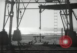 Image of oil derricks Huntington Beach California USA, 1938, second 11 stock footage video 65675037514