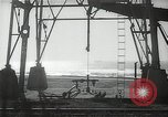 Image of oil derricks Huntington Beach California USA, 1938, second 12 stock footage video 65675037514