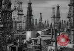 Image of oil derricks Huntington Beach California USA, 1938, second 1 stock footage video 65675037515