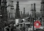 Image of oil derricks Huntington Beach California USA, 1938, second 2 stock footage video 65675037515