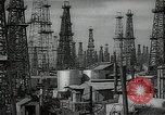 Image of oil derricks Huntington Beach California USA, 1938, second 3 stock footage video 65675037515