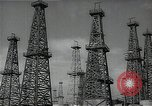 Image of oil derricks Huntington Beach California USA, 1938, second 4 stock footage video 65675037515