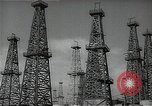 Image of oil derricks Huntington Beach California USA, 1938, second 6 stock footage video 65675037515