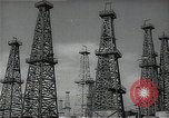 Image of oil derricks Huntington Beach California USA, 1938, second 7 stock footage video 65675037515