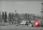 Image of oil derricks Huntington Beach California USA, 1938, second 8 stock footage video 65675037515