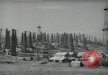 Image of oil derricks Huntington Beach California USA, 1938, second 9 stock footage video 65675037515