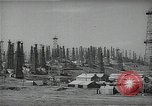 Image of oil derricks Huntington Beach California USA, 1938, second 10 stock footage video 65675037515