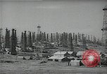 Image of oil derricks Huntington Beach California USA, 1938, second 11 stock footage video 65675037515