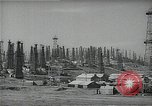 Image of oil derricks Huntington Beach California USA, 1938, second 12 stock footage video 65675037515