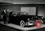 Image of Pontiac Parisienne and Oldsmobile Starfire New York City USA, 1953, second 1 stock footage video 65675037645