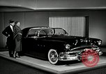Image of Pontiac Parisienne and Oldsmobile Starfire New York City USA, 1953, second 2 stock footage video 65675037645