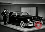 Image of Pontiac Parisienne and Oldsmobile Starfire New York City USA, 1953, second 3 stock footage video 65675037645