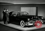 Image of Pontiac Parisienne and Oldsmobile Starfire New York City USA, 1953, second 7 stock footage video 65675037645