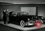 Image of Pontiac Parisienne and Oldsmobile Starfire New York City USA, 1953, second 8 stock footage video 65675037645