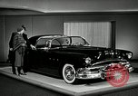Image of Pontiac Parisienne and Oldsmobile Starfire New York City USA, 1953, second 10 stock footage video 65675037645