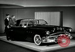 Image of Pontiac Parisienne and Oldsmobile Starfire New York City USA, 1953, second 12 stock footage video 65675037645