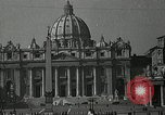 Image of Torch lights mounted on Saint Peter's Basilica Rome Italy, 1935, second 2 stock footage video 65675037669