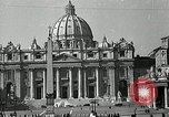 Image of Torch lights mounted on Saint Peter's Basilica Rome Italy, 1935, second 3 stock footage video 65675037669