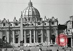 Image of Torch lights mounted on Saint Peter's Basilica Rome Italy, 1935, second 4 stock footage video 65675037669