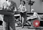 Image of Hollywood stars assembling a jig saw puzzle Universal City California USA, 1933, second 11 stock footage video 65675037678