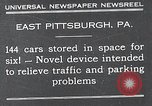 Image of vertical car park East Pittsburgh Pennsylvania USA, 1932, second 1 stock footage video 65675037699