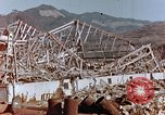 Image of wrecked steel frame Nagasaki Japan, 1946, second 4 stock footage video 65675037802