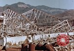 Image of wrecked steel frame Nagasaki Japan, 1946, second 6 stock footage video 65675037802