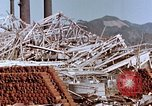 Image of wrecked steel frame Nagasaki Japan, 1946, second 8 stock footage video 65675037803