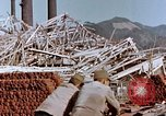 Image of wrecked steel frame Nagasaki Japan, 1946, second 10 stock footage video 65675037803