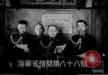 Image of Japanese admirals appeal by radio to defense workers Japan, 1944, second 2 stock footage video 65675037851