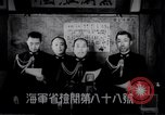 Image of Japanese admirals appeal by radio to defense workers Japan, 1944, second 3 stock footage video 65675037851
