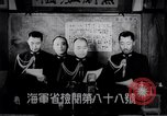Image of Japanese admirals appeal by radio to defense workers Japan, 1944, second 4 stock footage video 65675037851