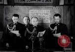 Image of Japanese admirals appeal by radio to defense workers Japan, 1944, second 5 stock footage video 65675037851