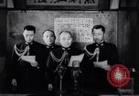 Image of Japanese admirals appeal by radio to defense workers Japan, 1944, second 8 stock footage video 65675037851