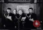 Image of Japanese admirals appeal by radio to defense workers Japan, 1944, second 9 stock footage video 65675037851