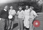 Image of Bing Crosby leads companions singing on golf course Washington DC USA, 1956, second 1 stock footage video 65675037953