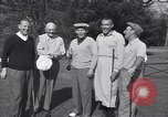 Image of Bing Crosby leads companions singing on golf course Washington DC USA, 1956, second 2 stock footage video 65675037953